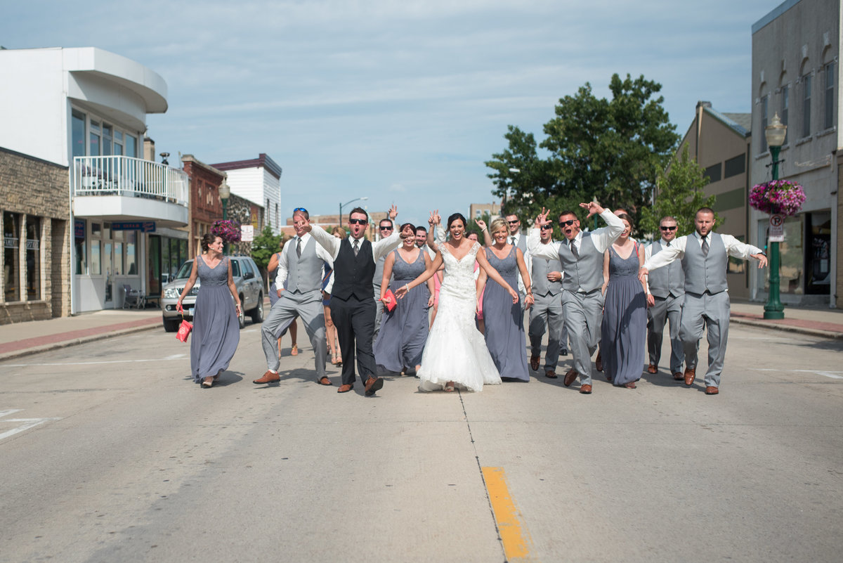 bridal party walking on street having fun