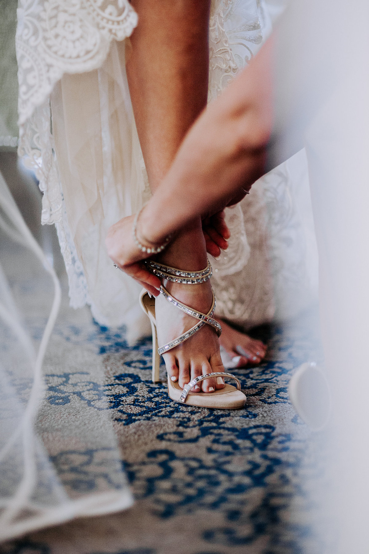 Lake Tahoe wedding photo of bride putting shoes on