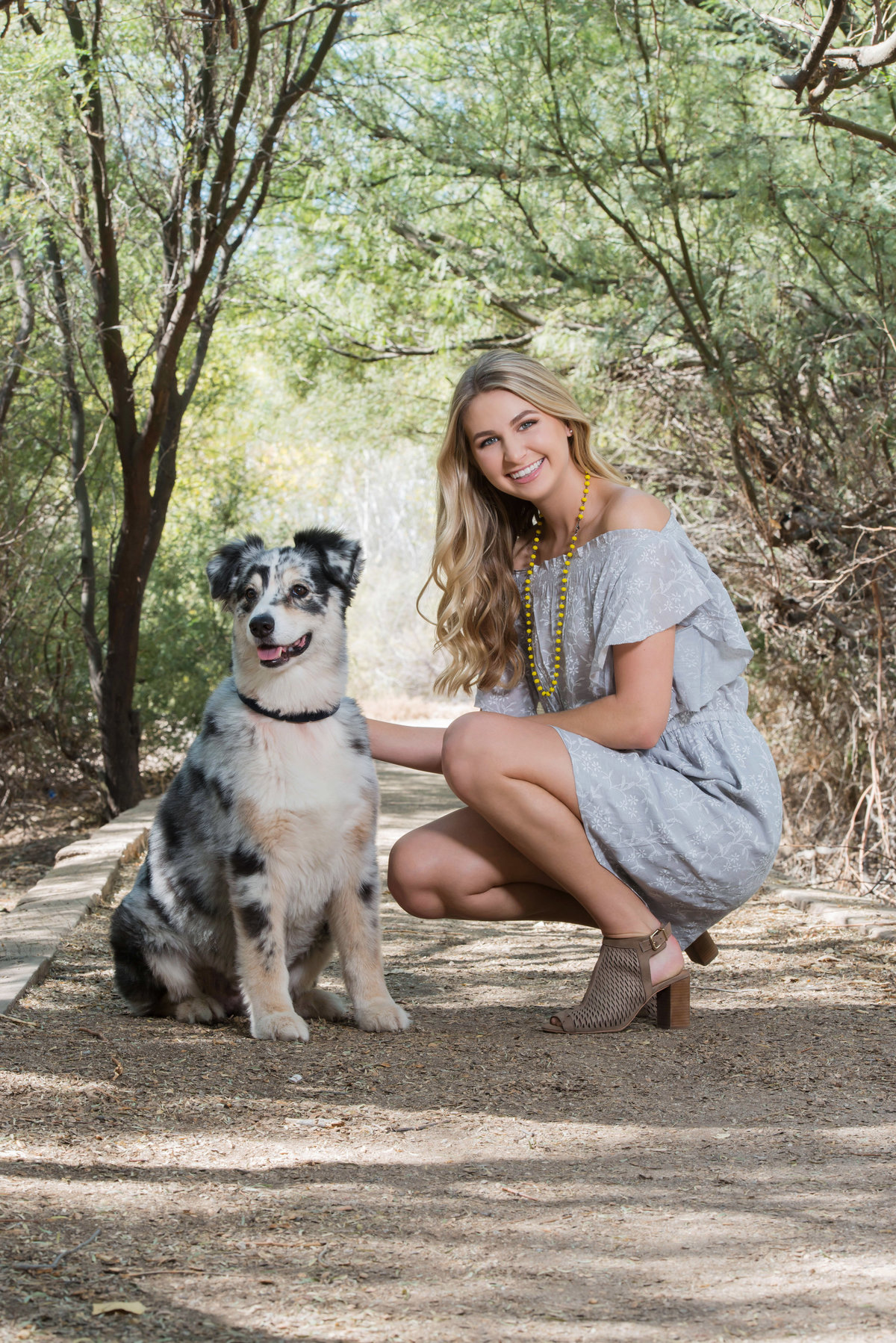 senior wih grey dress and dog