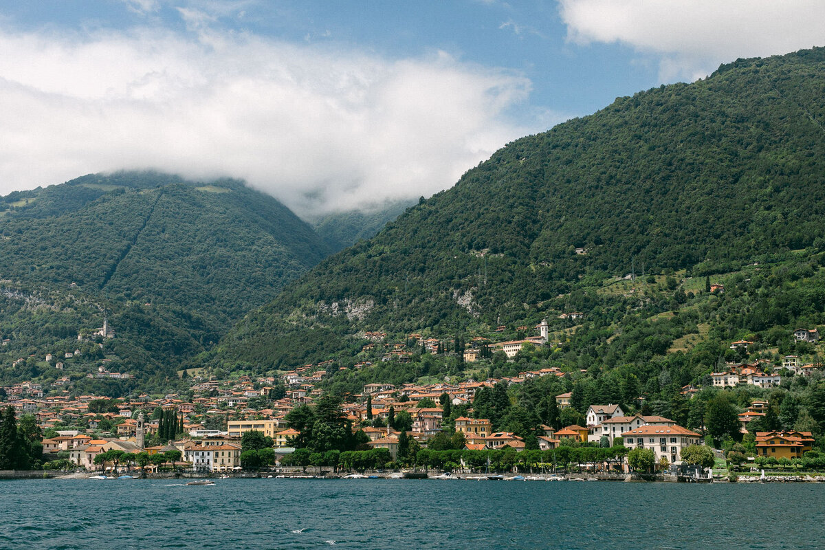 View of Lake Como Italy town on green mountains