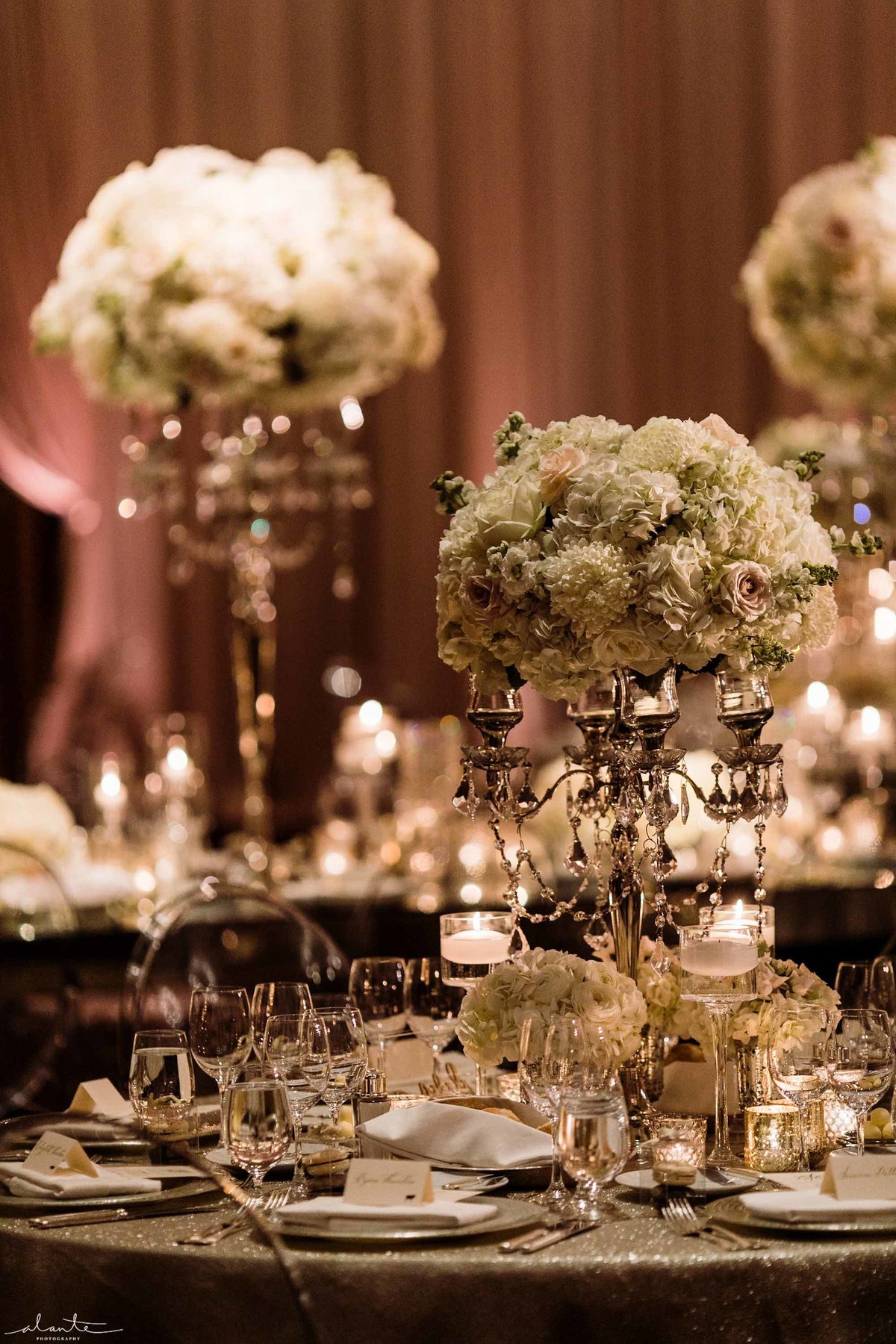 White and silver floral flowers on silver crystal candelabras