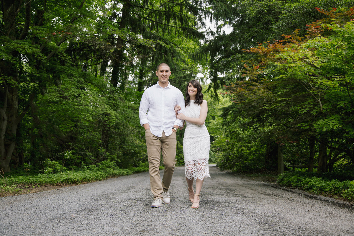 engaged couple walking at sayen gardens