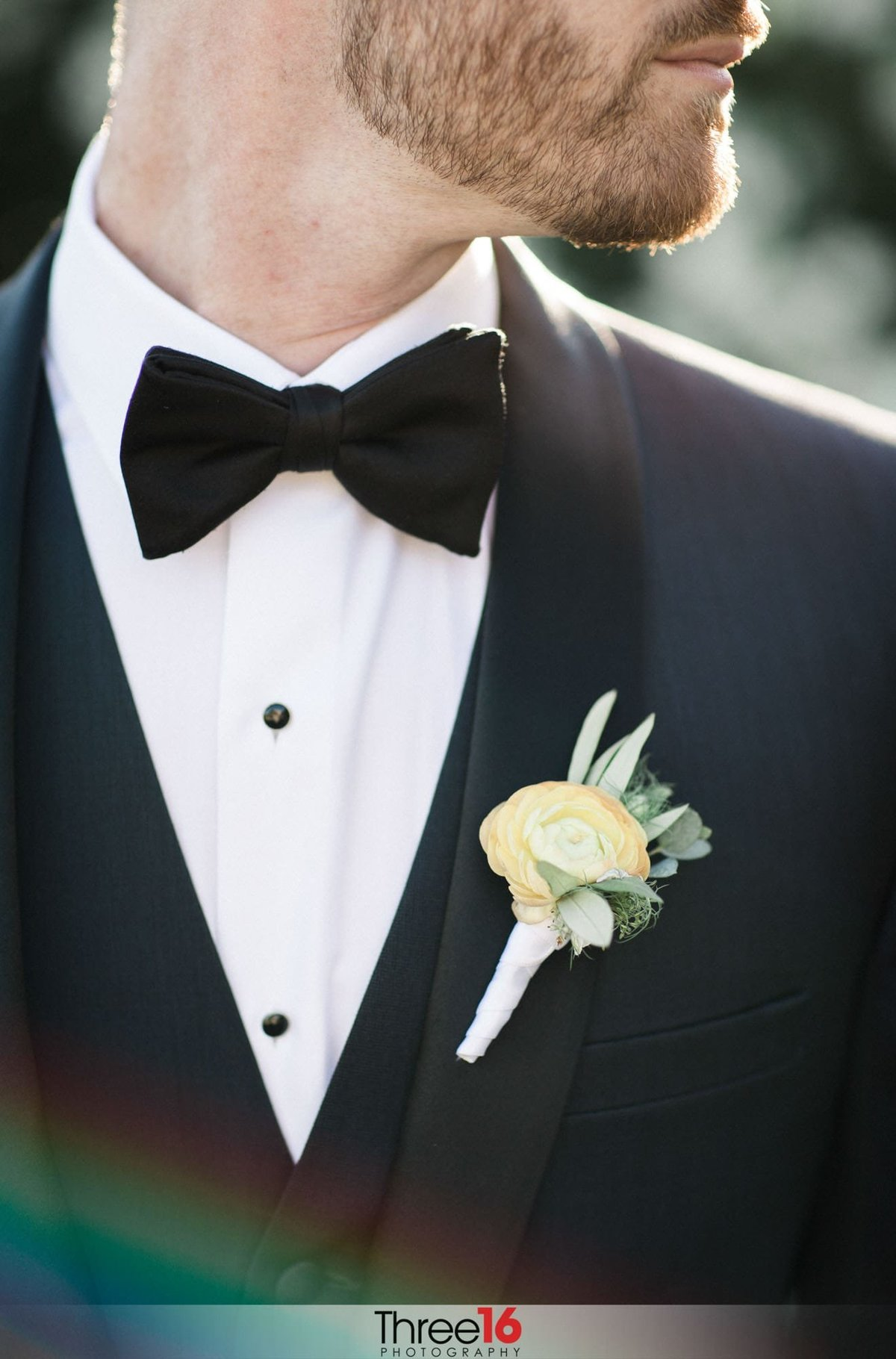 Grooms yellow rose boutonniere