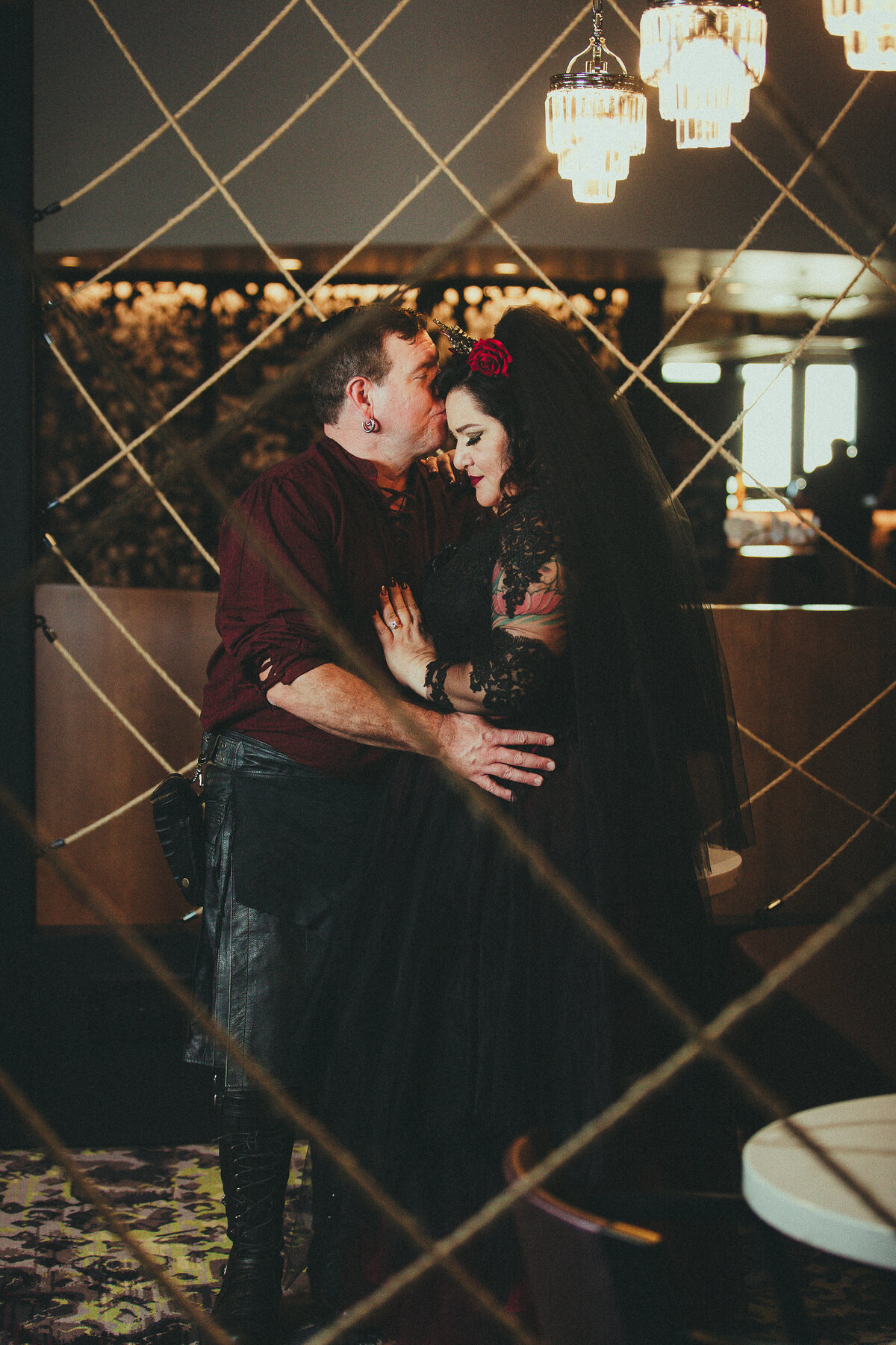 gothic bride and groom embrace savannah ga destination wedding breaking tradition