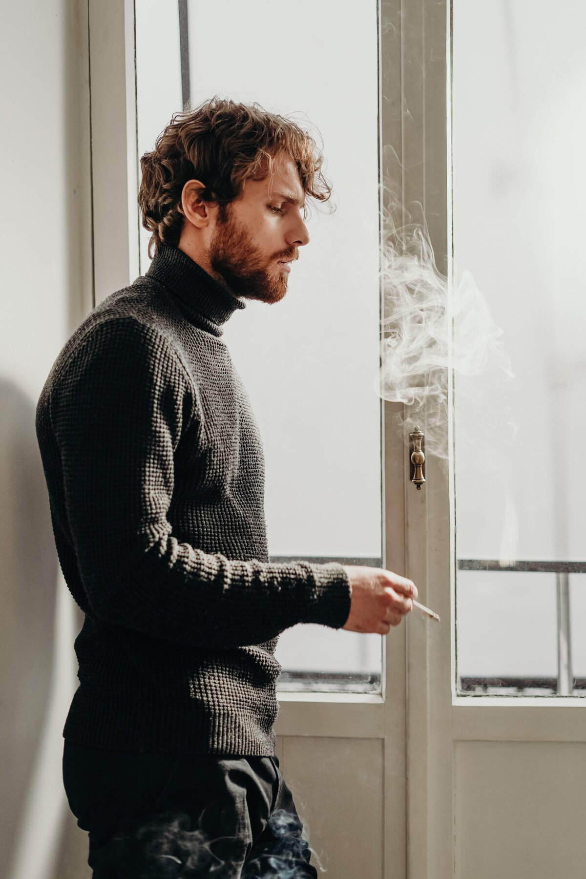 side-view-photo-of-man-in-black-sweater-standing-beside-3692904