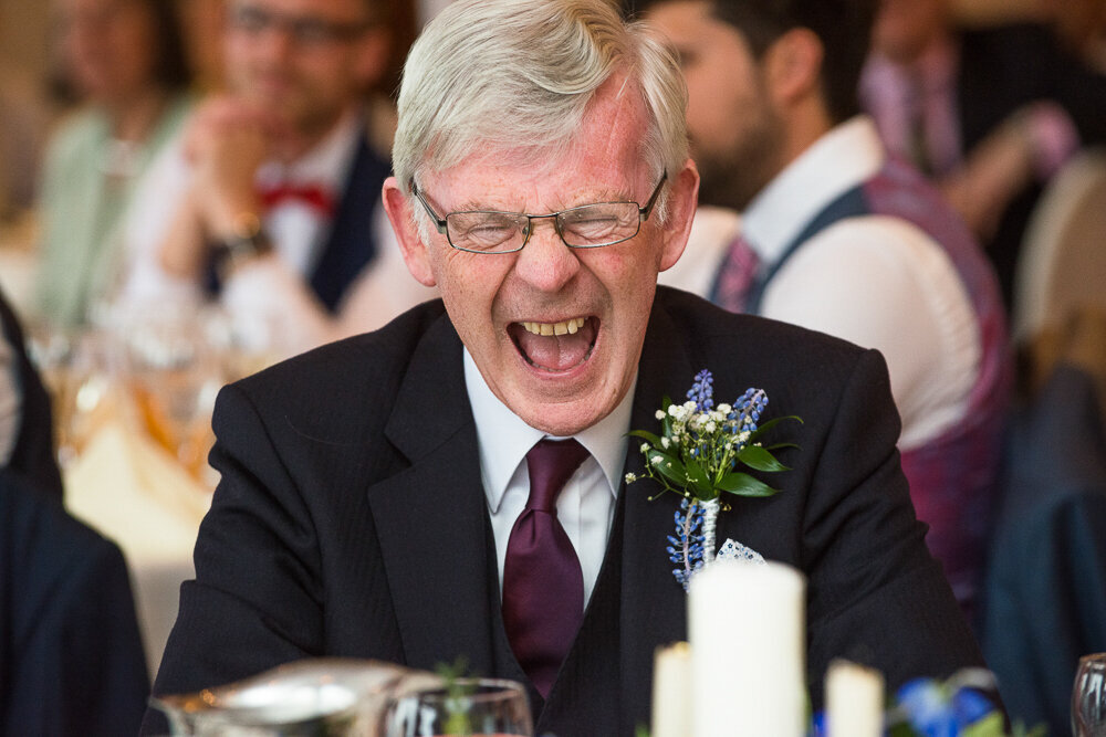 father of the bride laughing out loud at the wedding reception in hotel in Kerry