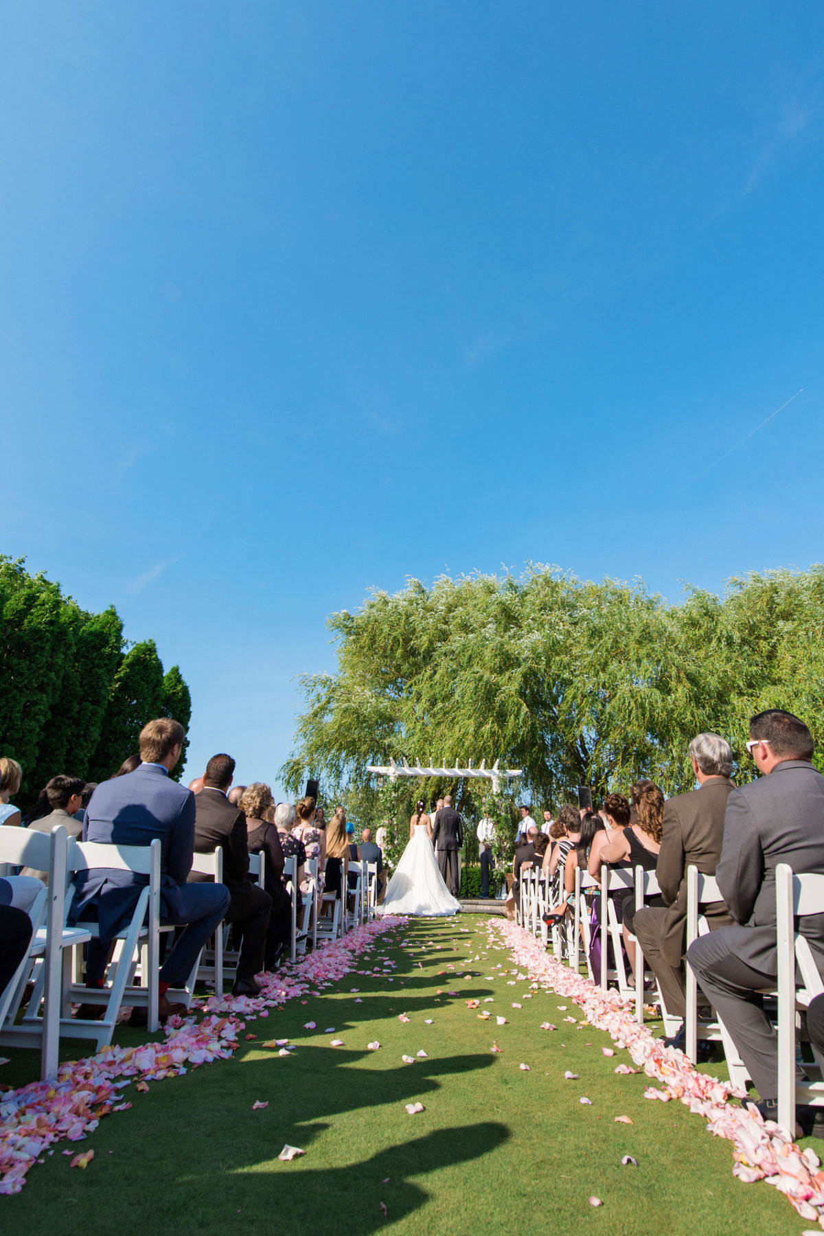 photo of summer outside wedding ceremony at Willow Creek Golf and Country Club