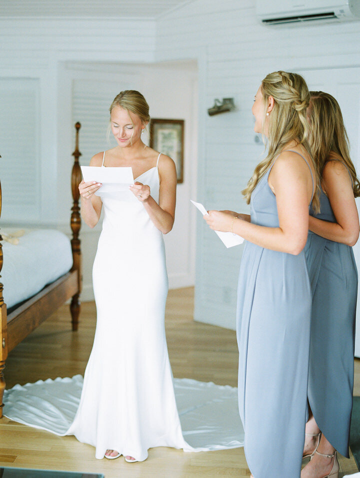bride reading a note from groom during getting ready photos