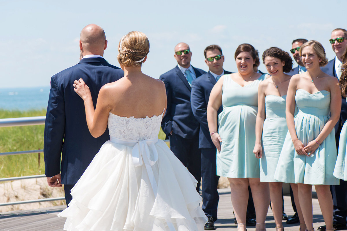 photo of bride and groom right before the first look during wedding beach reception at Pavilion at Sunken Meadow