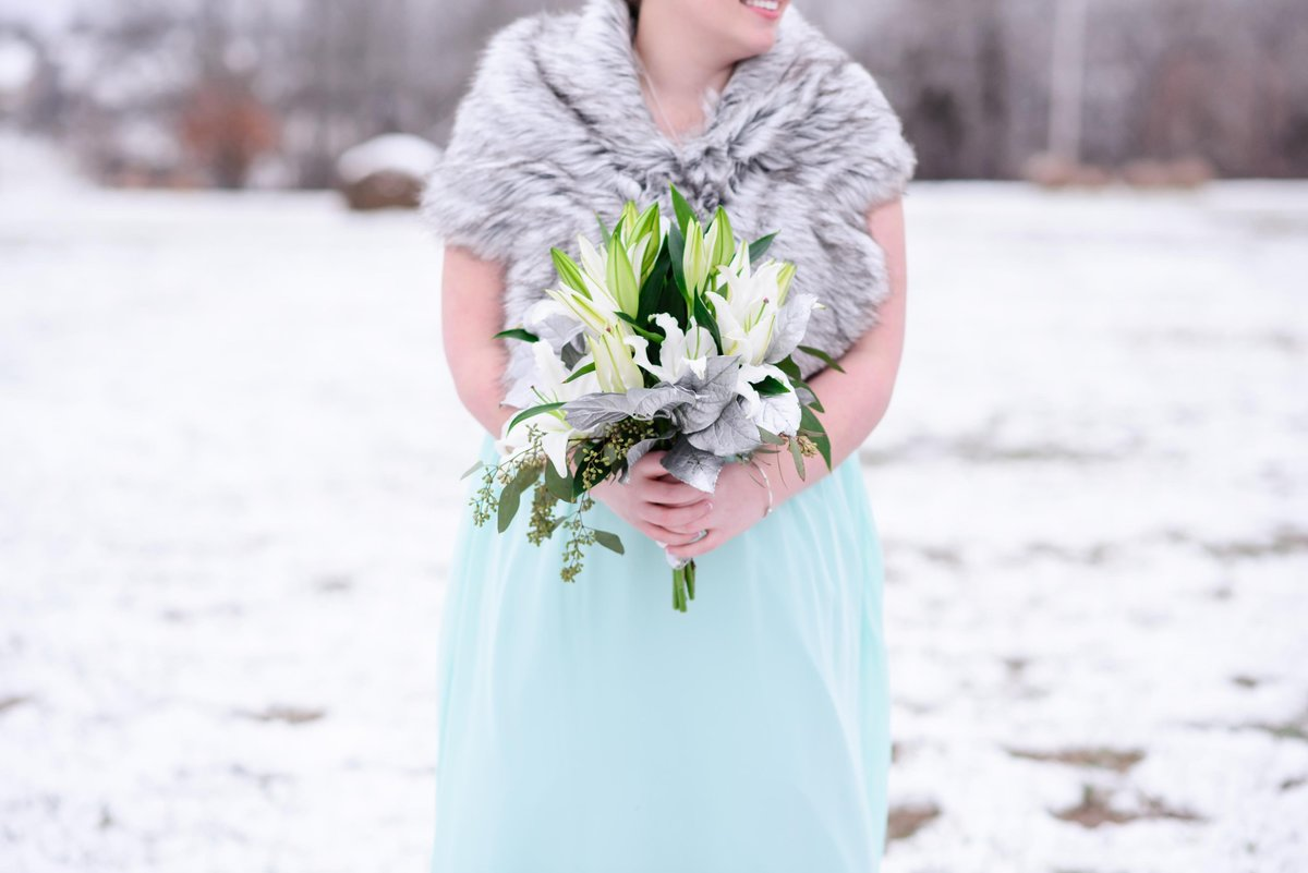 Gorgeous teal bridesmaid dress with big bouquet