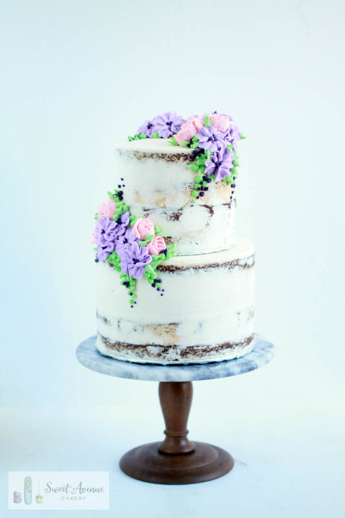 rustic semi naked buttercream wedding cake with piped buttercream flowers, wedding cakes Niagara