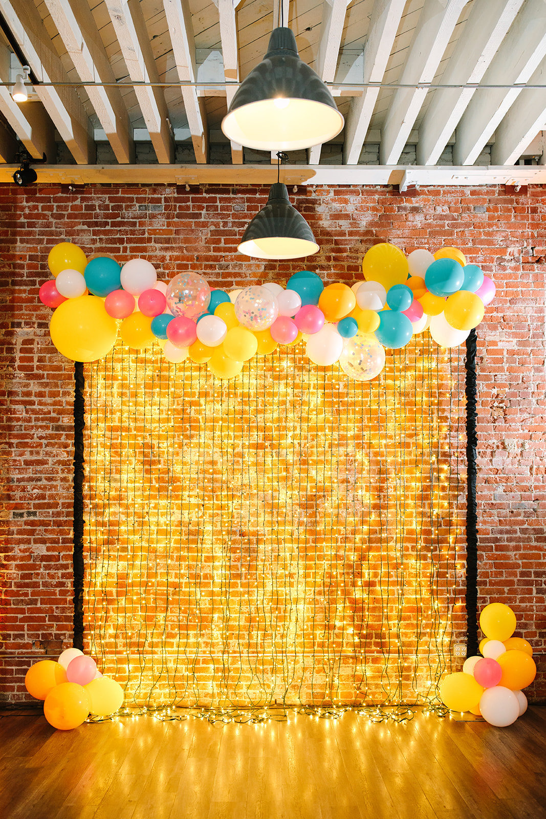Wedding reception photobooth backrop with gold lights and balloons at The Uniqe Space LA