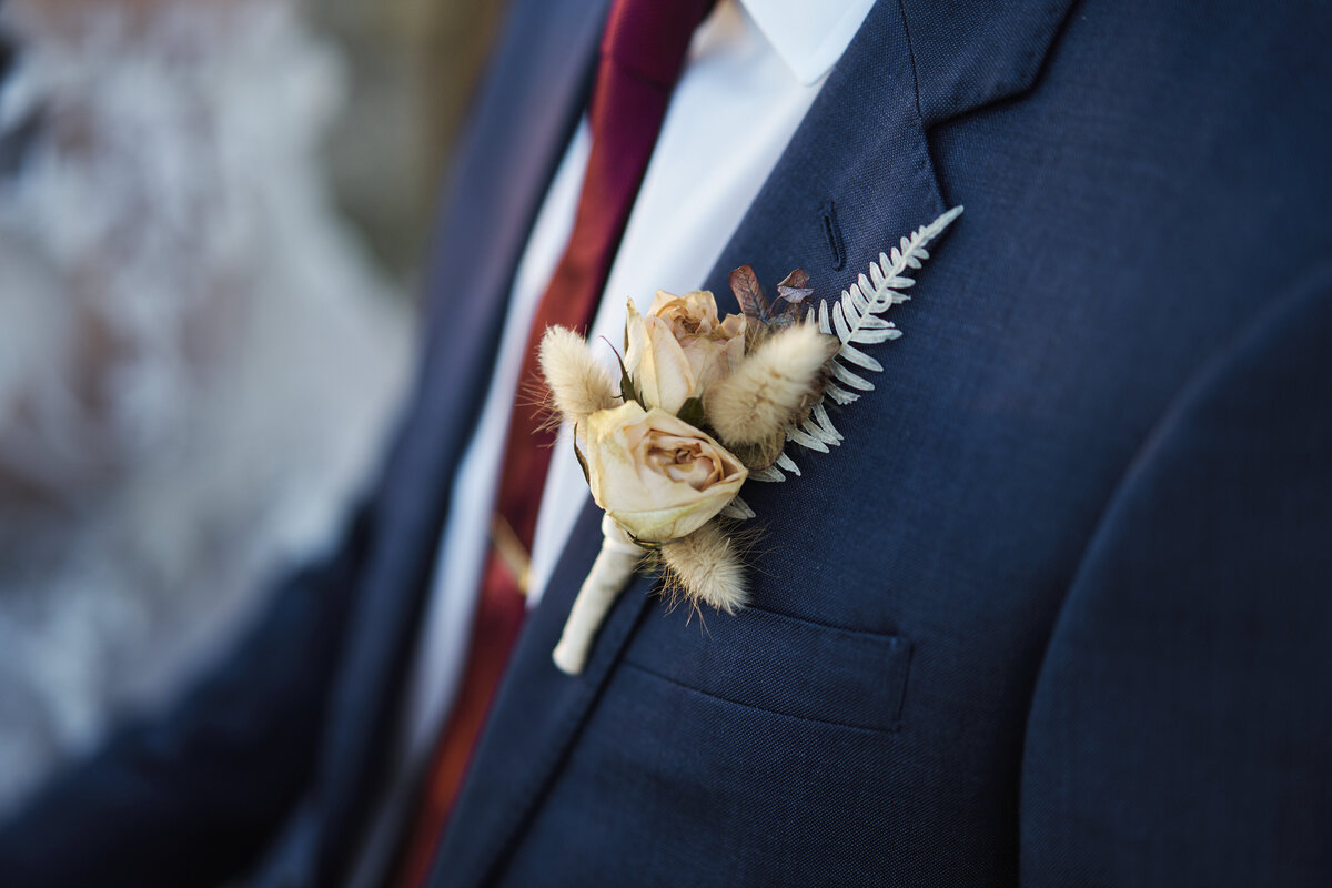 groom wedding flower
