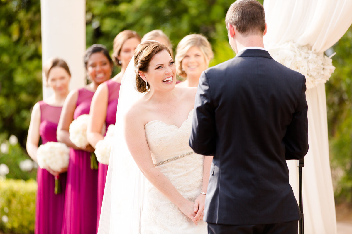 Bride laughs at her husband's speech during their wedding ceremony at villa de amore by matty fran photography