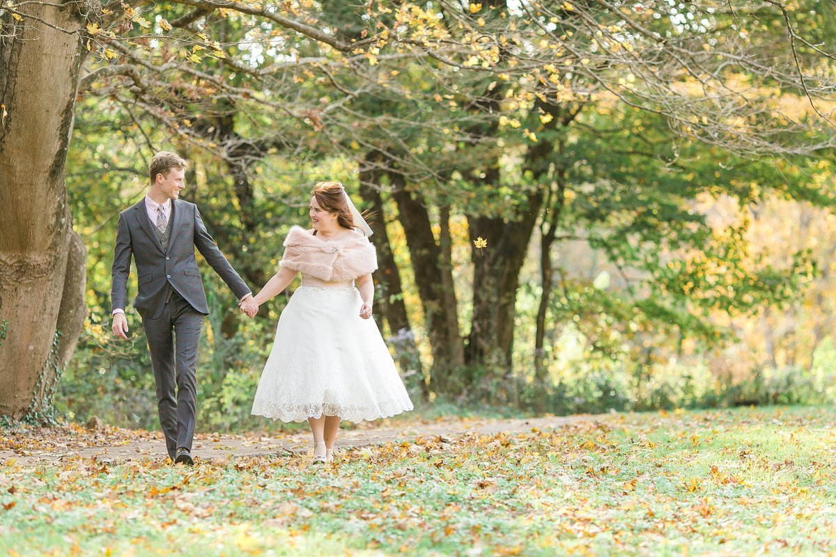 bride-groom-walking-holding-hands-vintage-dress