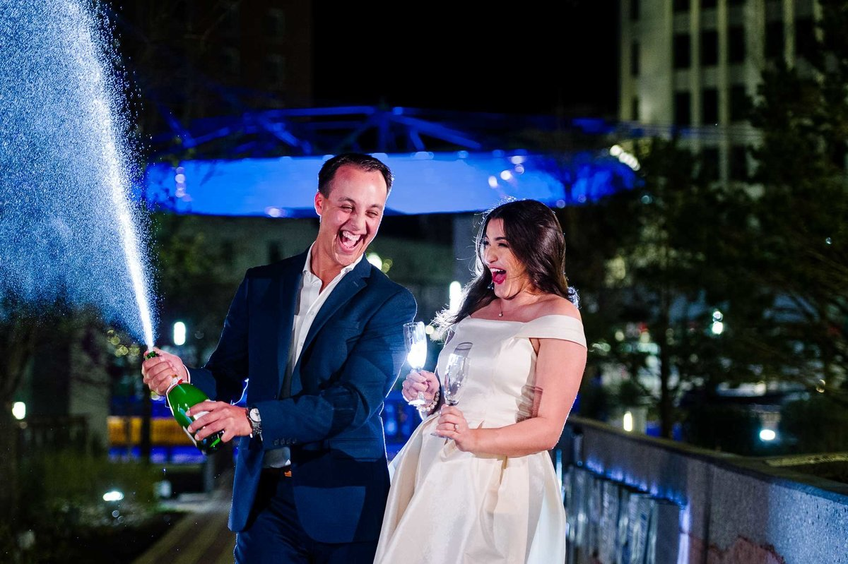 engagement photo at san jacinto plaza with champagne in el paso texas by stephane lemaire photography