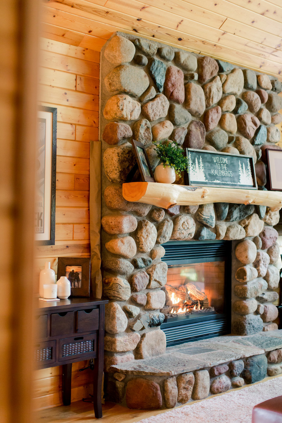 wooden cabin and stone fireplace on gull lake