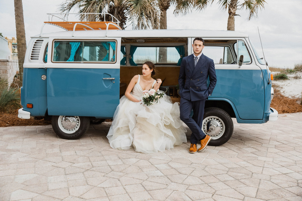 Bride and groom  formal portraits with a vintage VW Bus at a wedding venue in near Destin, Florida.