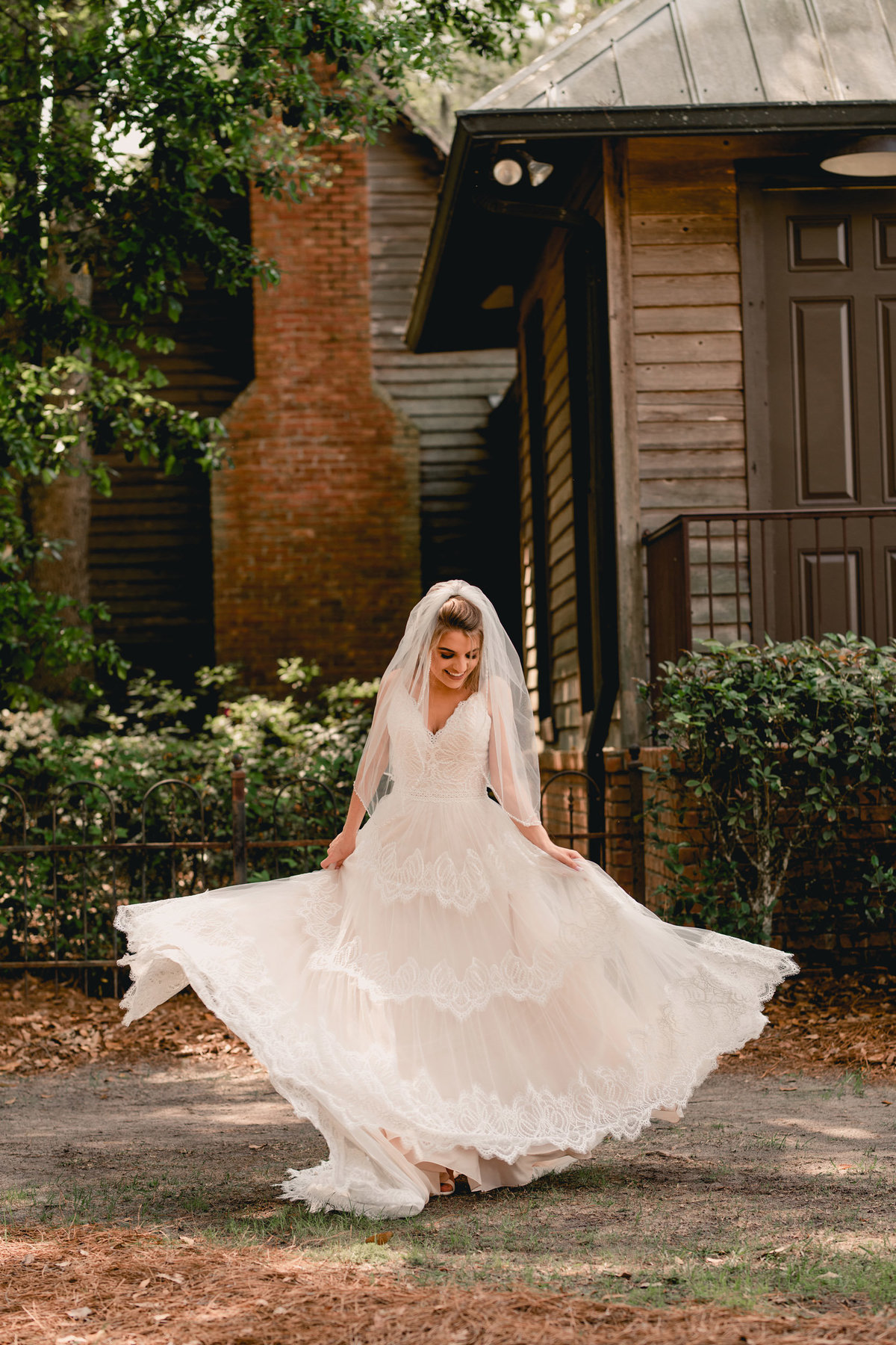 Fun lifestyle wedding photographer in Florida has bride spin in circles.