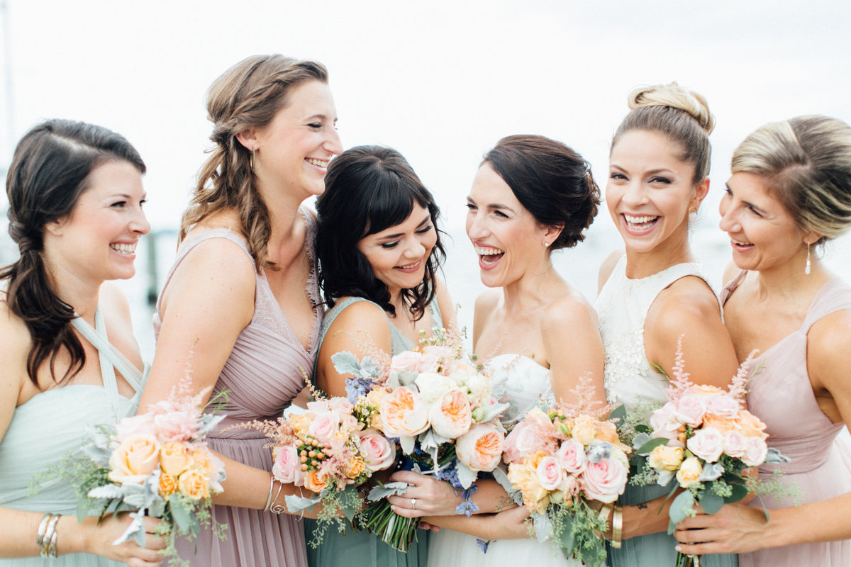 Bridesmaids laughing mismatched dresses Annapolis Maritime Museum wedding
