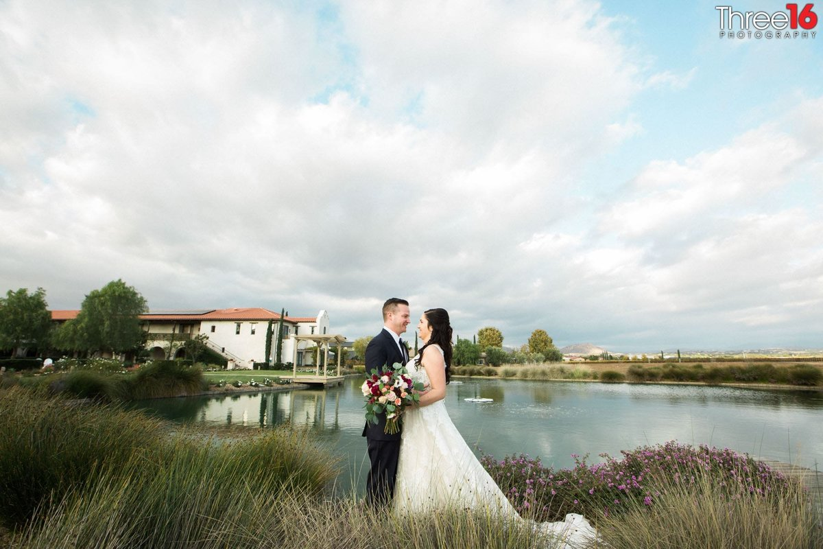 Bride and Groom in the fields next to a small lake