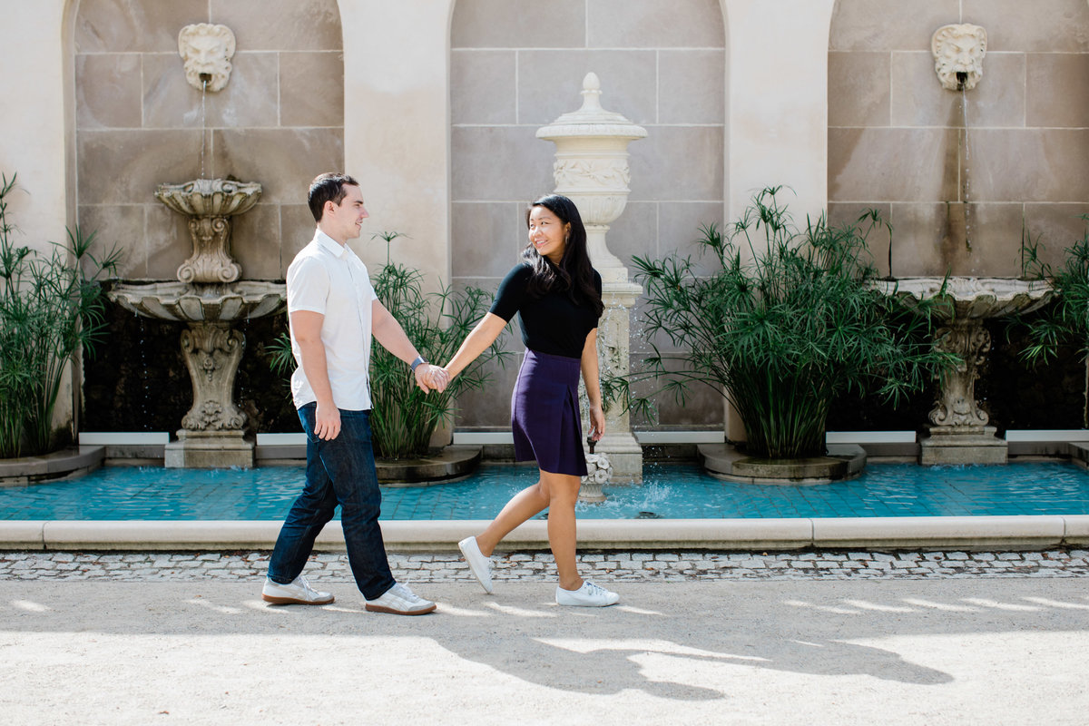 Couple walking by the fountains