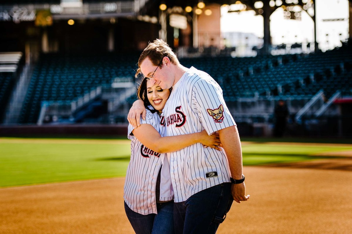 engagement photo at southwest university park in el paso texas by stephane lemaire photography