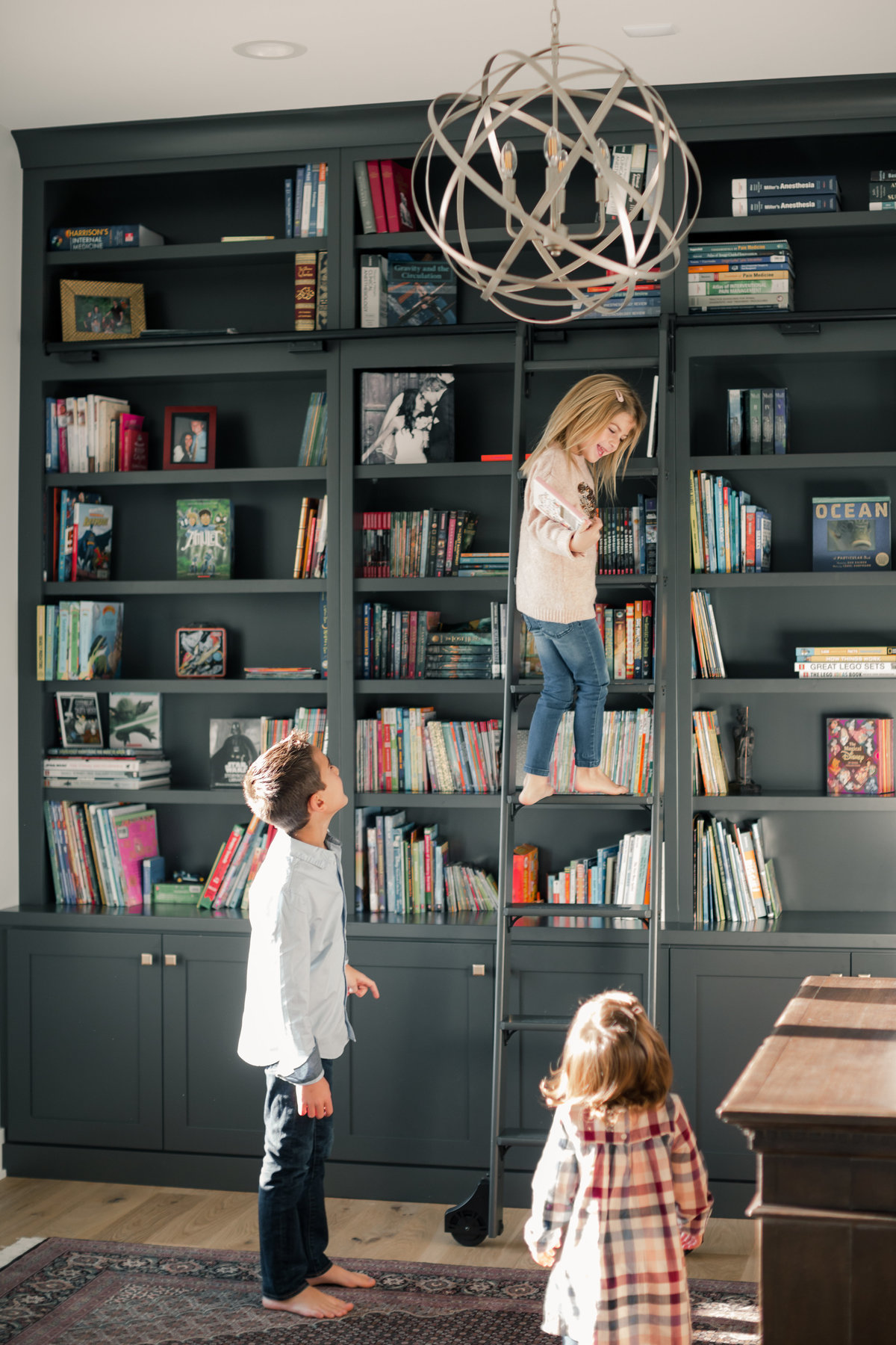 home office bookshelves with kids picking out books