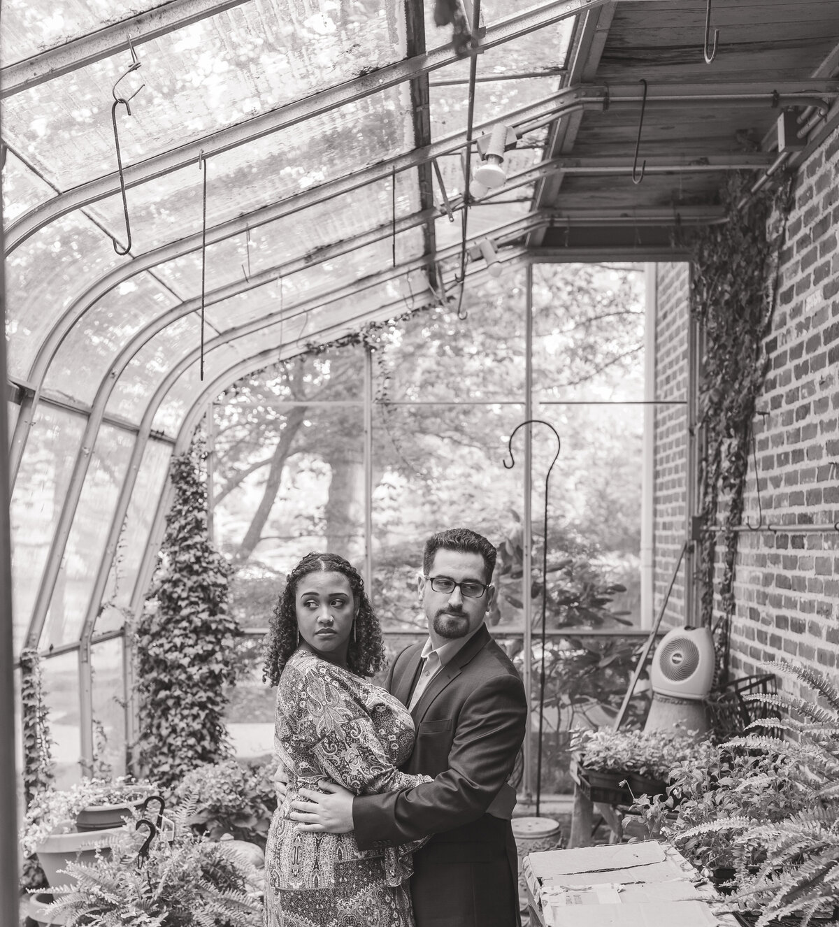 engaged couple standing in greenhouse smithville village, smithville, NJ