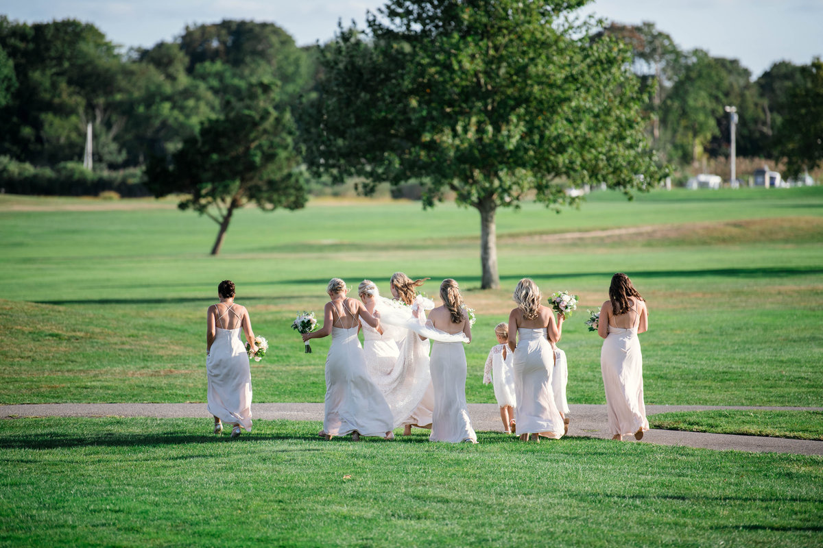 bridesmaids with bride on the greens for wedding at the Mansion at Timber Point