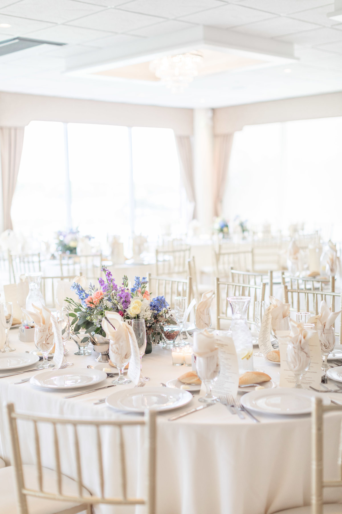 Davenport Mansion wedding reception with white wedding tablescape ideas and colorful wedding table floral arrangements