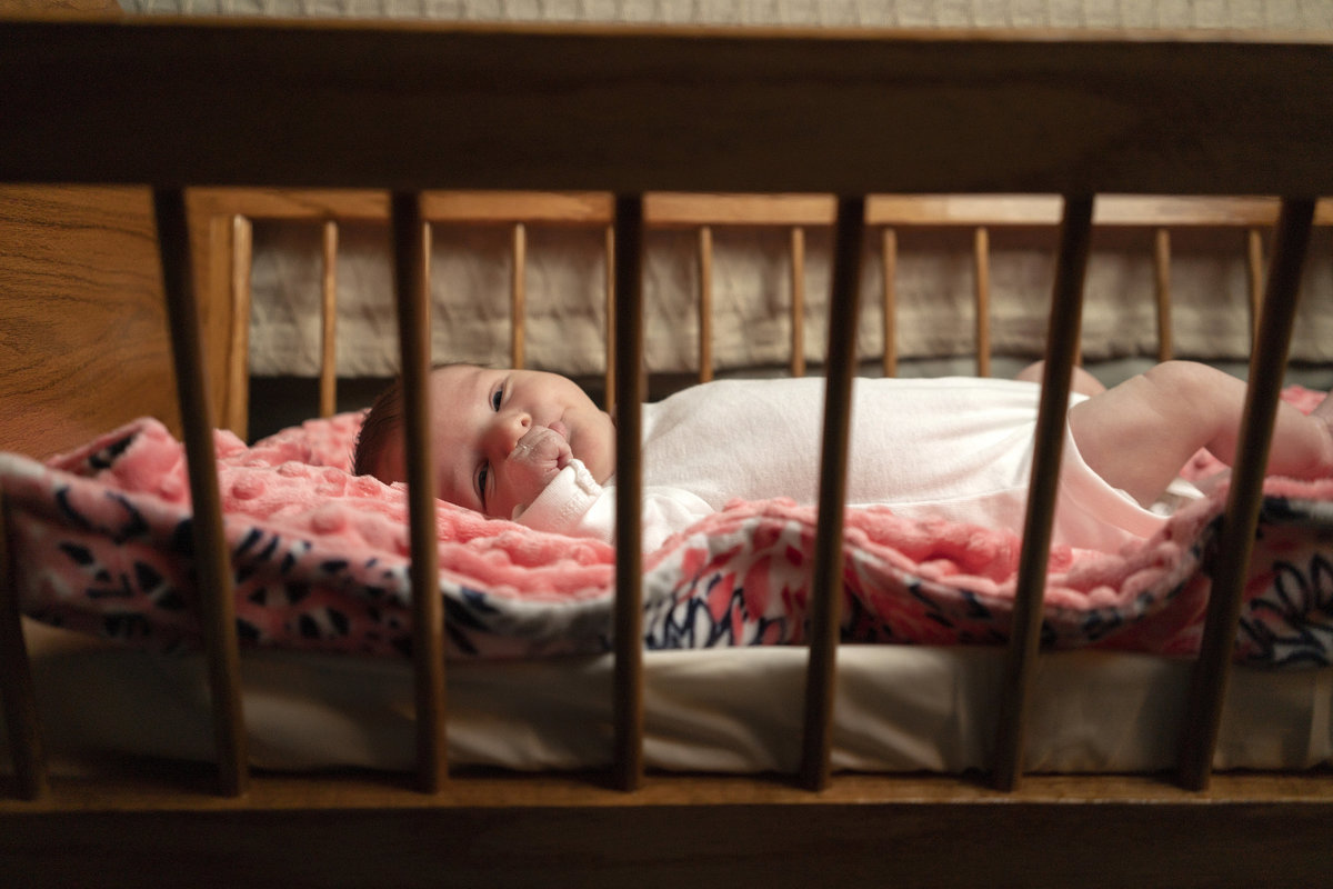 sioux falls family photography in home session baby sleeping in crib south dakota