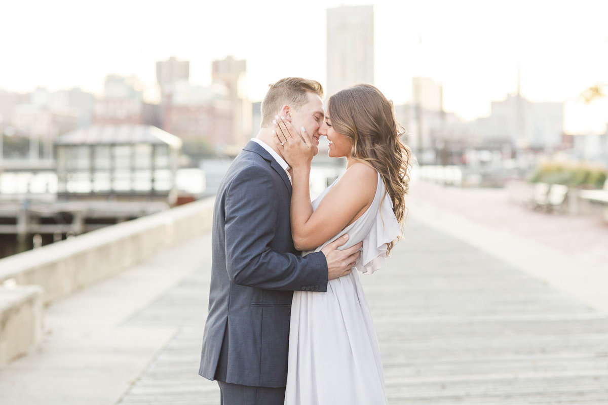 couple in Charlestown Navy Yard with Boston skyline in background