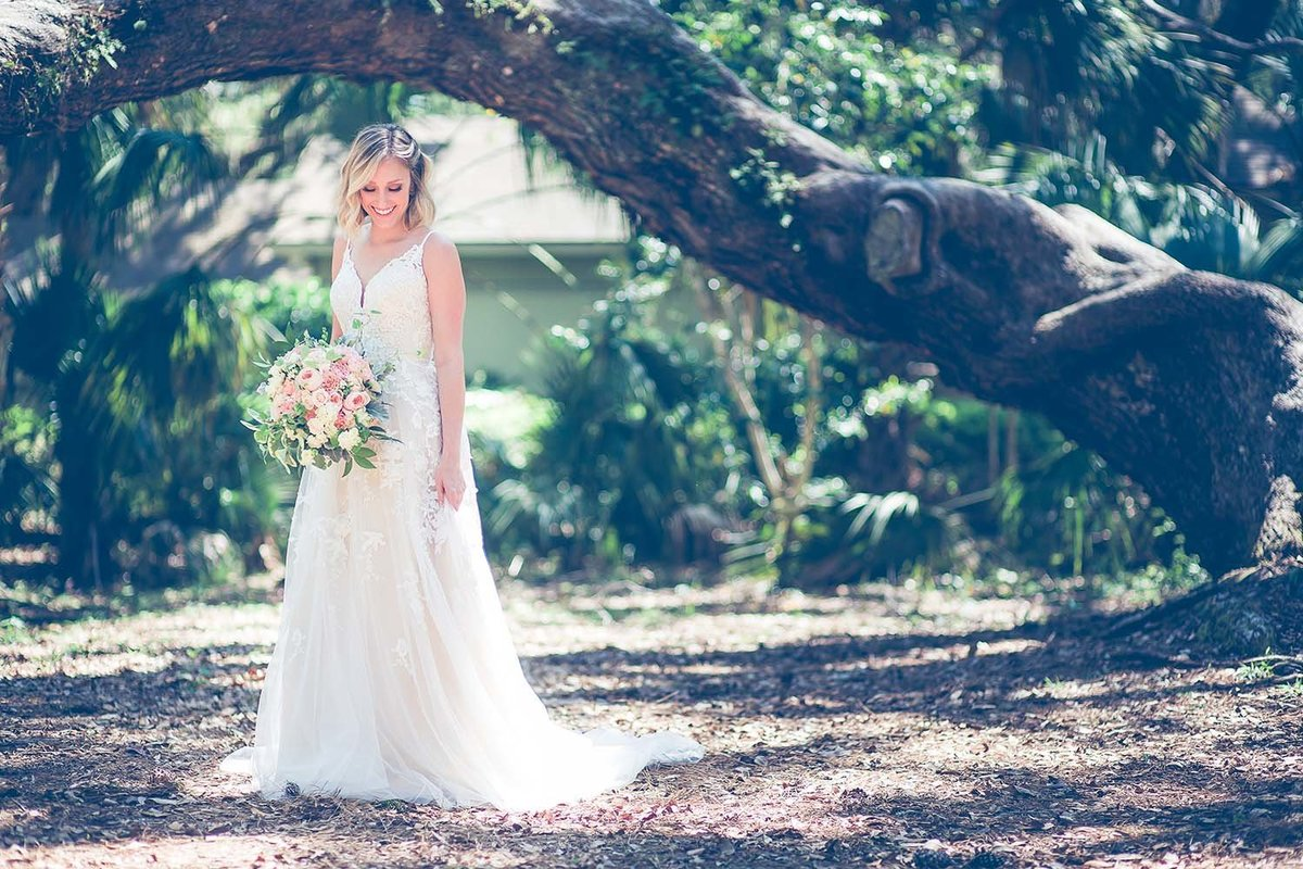 love-bridal-boutique-model-revalation-design-bouquet-wedding-dress-breaking-tradition-amelia-island-fl