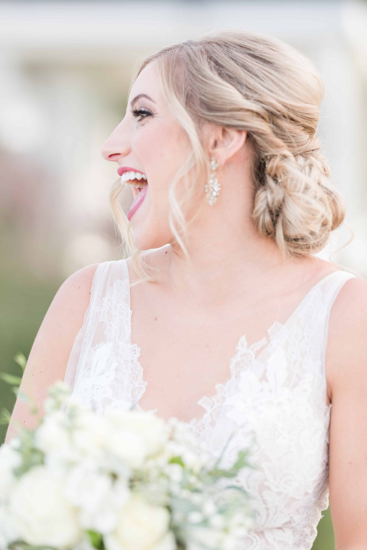 Bride laughing in bridal portrait.