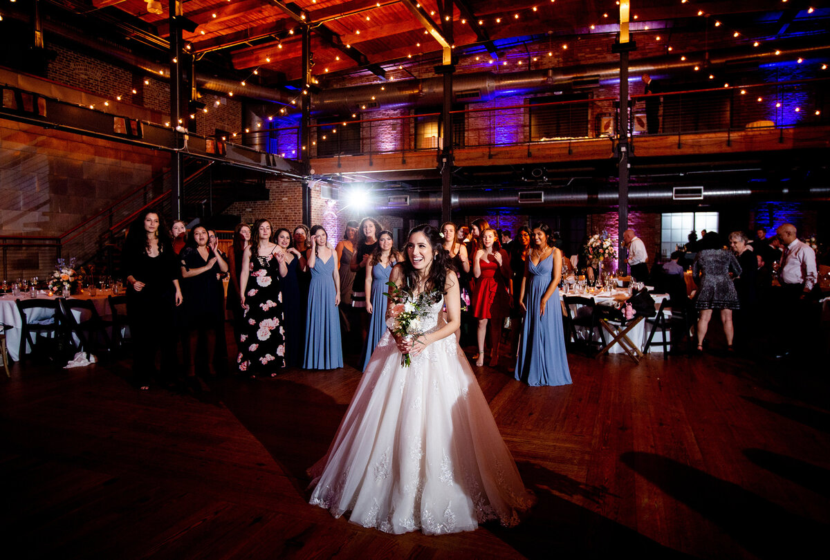 Bouquet toss and wedding reception in Durham, NC at Bay 7