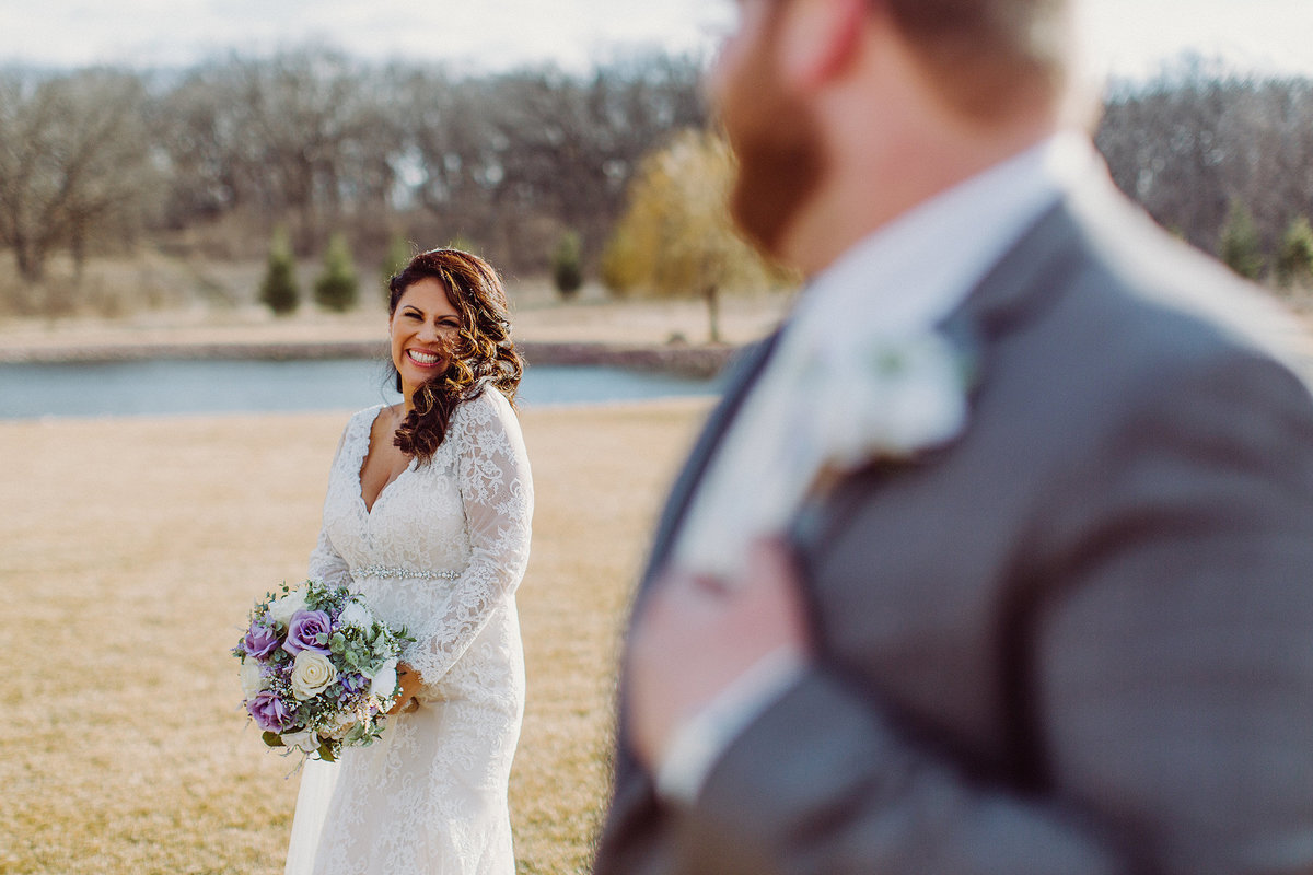 Bride looking at groom while laughing