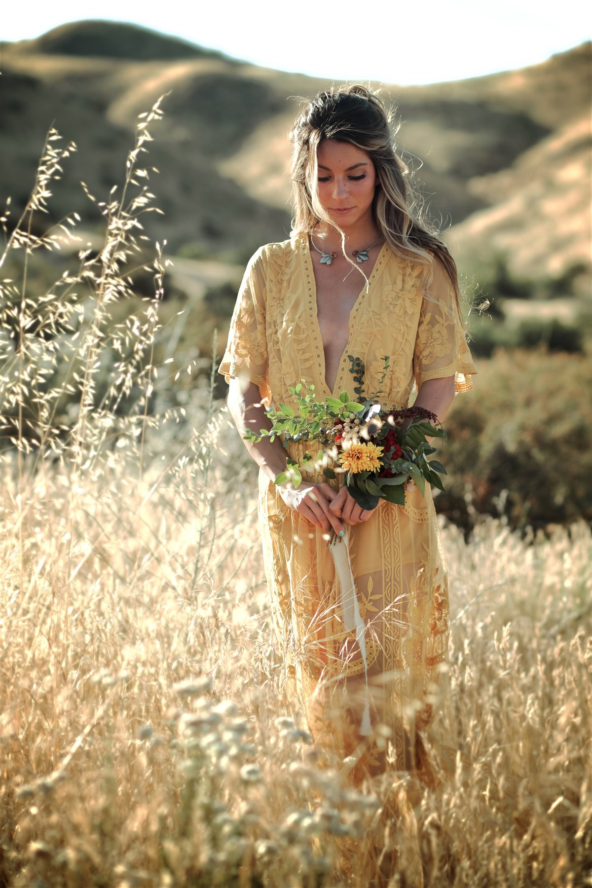Boho Vintage Girl in Mustard Yellow Dress in Field of Flowers Free-Spirited Bridesmaid Ideas
