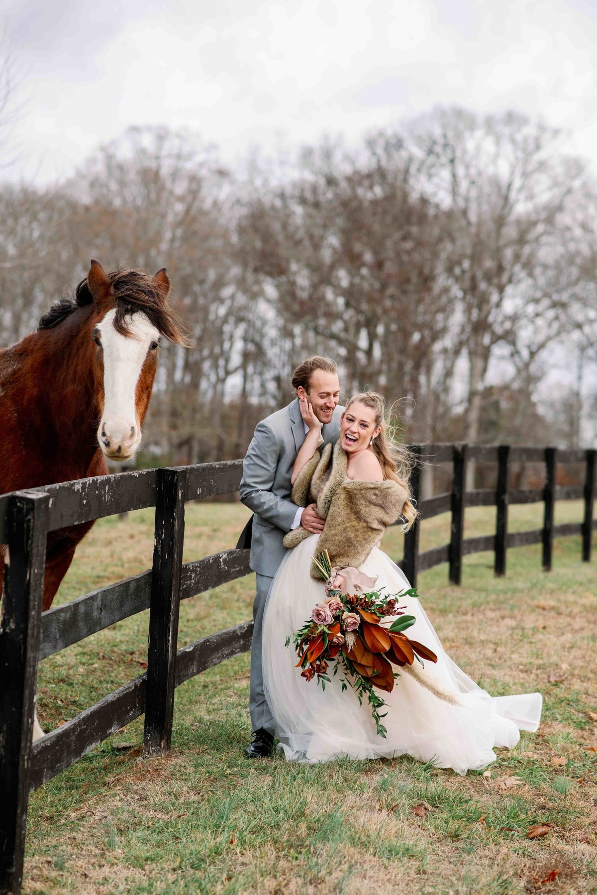 bride and groom laugh because horse is approaching them at the farm in virginia