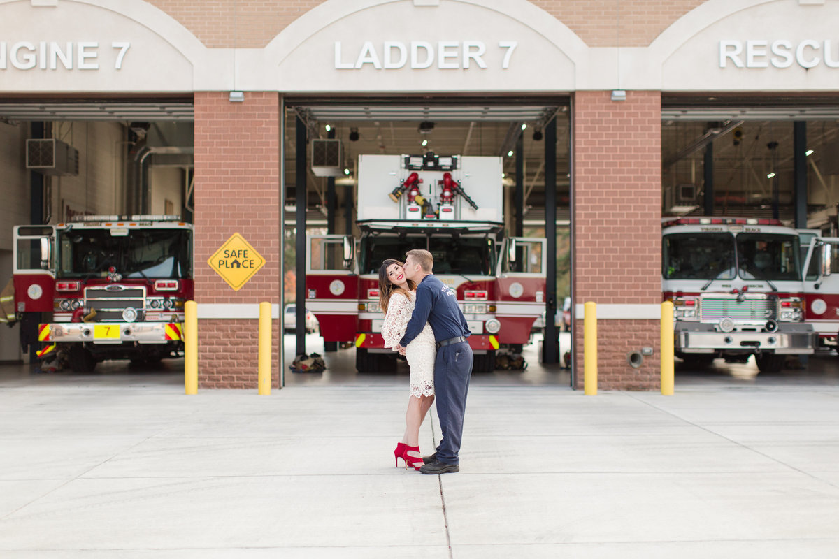 guy kissing girl in front of fire truck