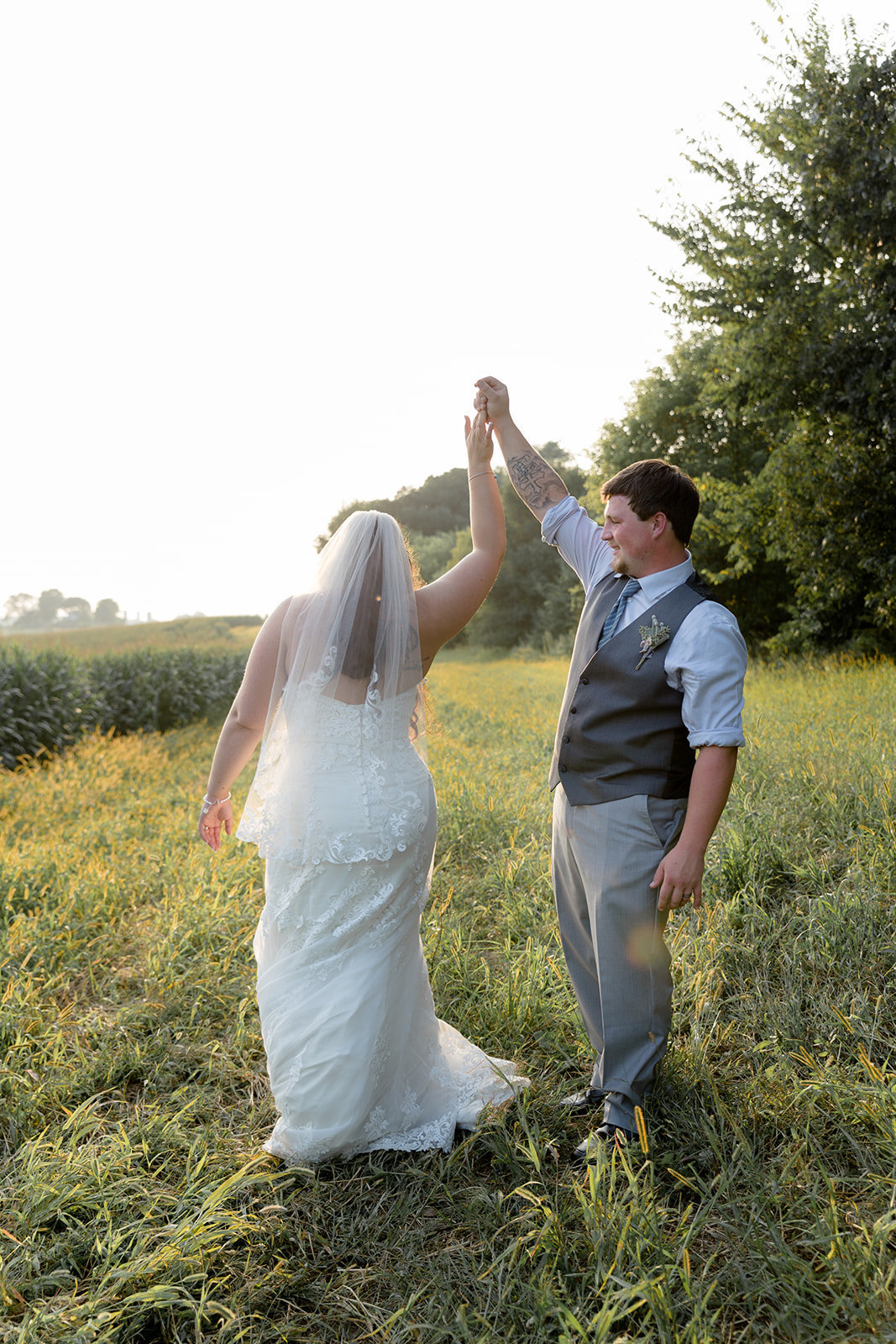 Sunset photos of bride and groom in middle of field in Prescott Wisconsin