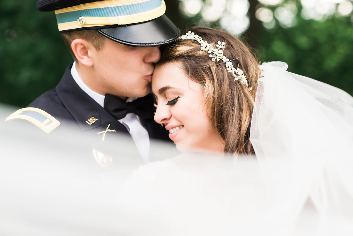 Bride and groom at West Point Military on wedding day overlooking the Hudson River