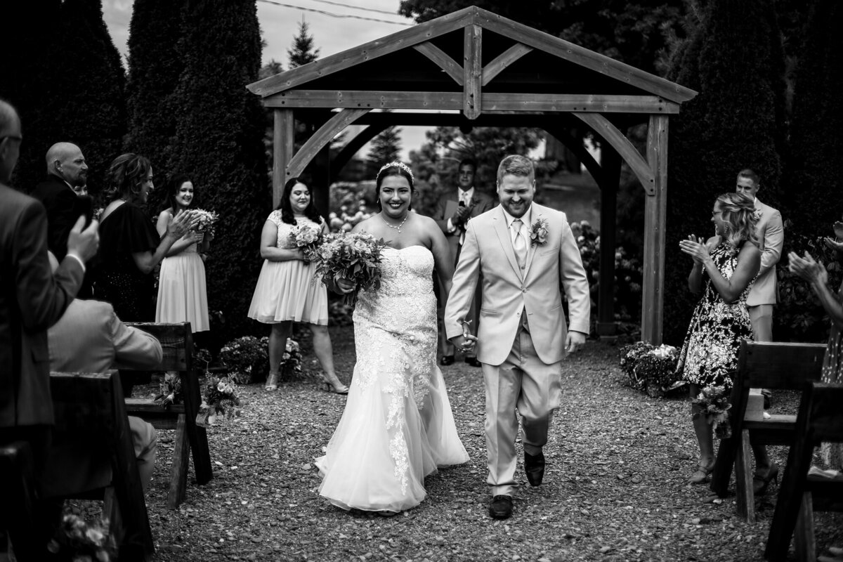 Recessional photo of bride and groom  at the end of their Port Farms wedding ceremony