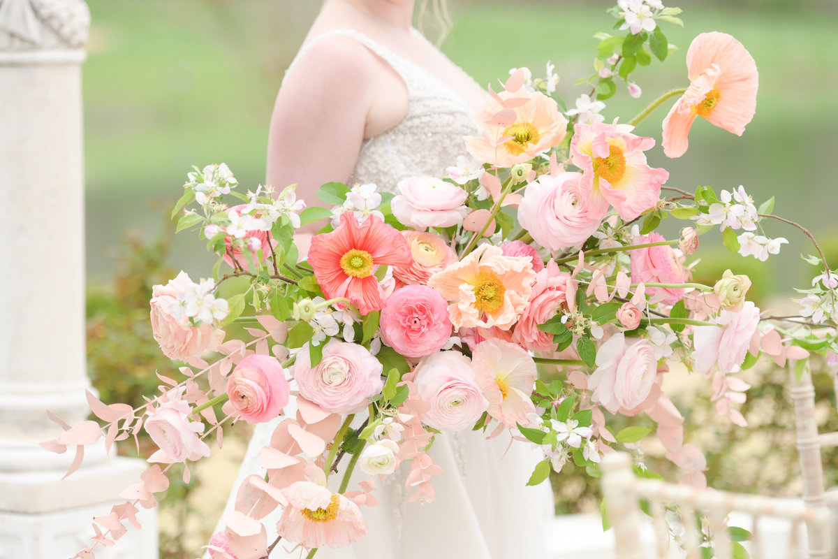 Beautiful big pink bouquet held by bride
