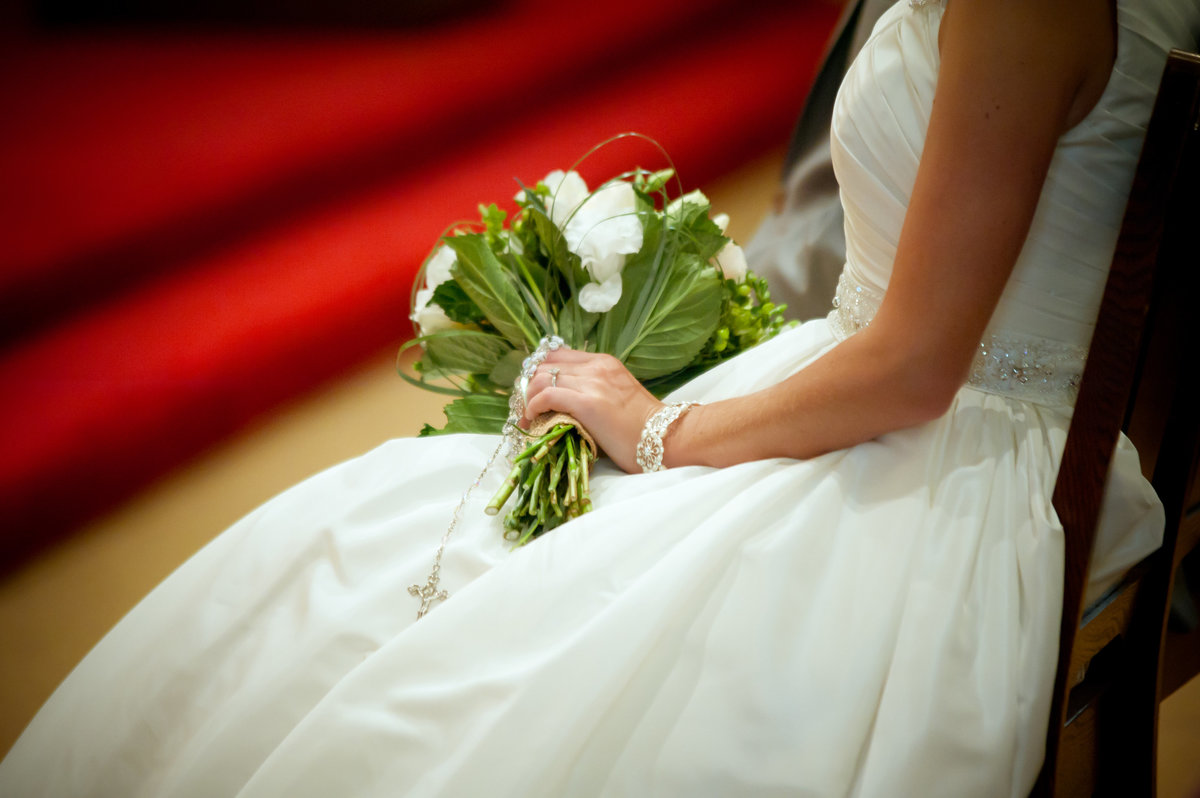bride sitting holding boquet