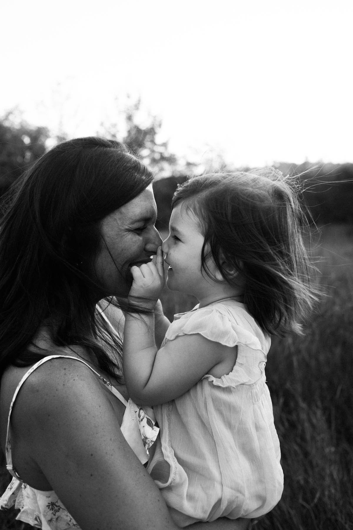 Mom and daughter touching nose to nose during photo session, Photo by Elle Baker Photography