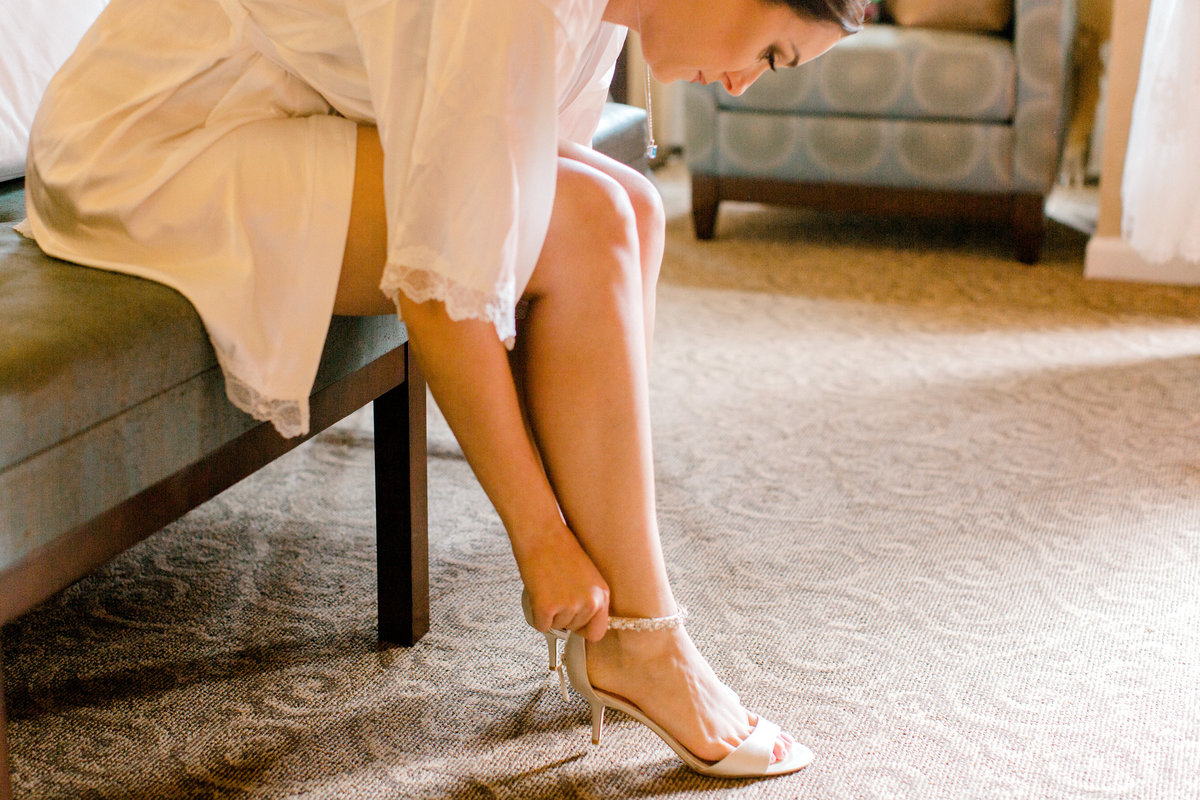 Bride putting on her shoes at Vintners Inn in Santa Rosa California
