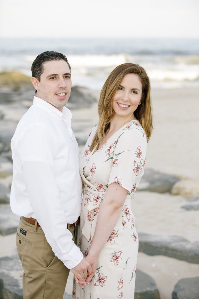 engaged couple on beach in spring lake
