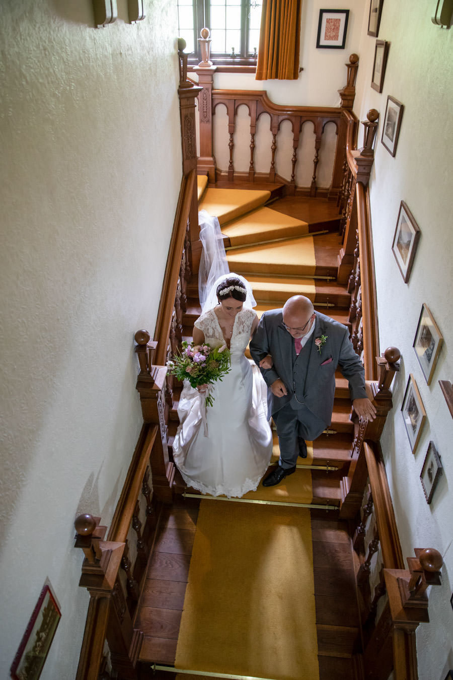 Bride and Dad walking down the stairs at Coombe Trenchard Wedding Devon
