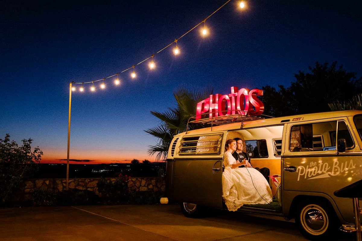 Bride and groom in a photobus at coronado country club in el paso by stephane lemaire photography
